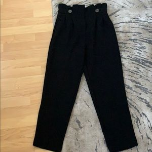 Black trousers with buttons in the front